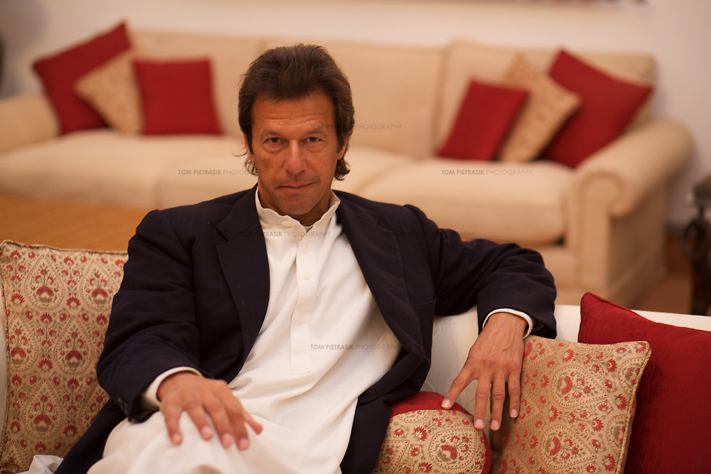 Imran Khan at home in Islamabad.<br /> <br /> Cricketer Imran Khan made his Test debut against England in 1971. He became captain of the Pakistan team in 1982 and lead them to World Cup victory in 1992 after which he retired.<br /> <br /> Imran Khan established the Tehrik-e-insaaf (or Moverment for Justice) in 1996. Through Tehrik-e-insaaf, Khan has demanded that the Pakistan government make institutional reforms to address corruption and end the present dictatorship. Khan would like a more equitable distribution of resources in Pakistan, the granting key civil liberties and an increas in public service spending. He is particularly scathing of the relationship between President Musharraf and US President Bush.<br /> <br /> Imran Khan became a Member of the Pakistani Parliament for Mianwali, Panjab, in the October 2002 elections.<br /> <br /> Photo: Tom Pietrasik<br /> Islamabad Pakistan<br /> 27th January 2006