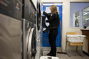 A prisoner washing her clothes in the laundry room. HM Prison Send is a Closed Category women's prison, located in the village of Send (near Woking), in Surrey, England. The prison is operated by Her Majesty's Prison Service. Send is a closed prison for adult females. In addition it also houses a 20 bed Addictive Treatment Unit, an 80 bed Resettlement Unit and a 40 bed Therapeutic Community. HMP Sends Education Department runs Key Skills courses and NVQs in Business Administration. The Farms and Gardens department offers Floristry NVQs, and the Works Department run an industrial workshop and painting party. Prisoners held in the Resettlement Unit can also do voluntary work, attend College courses and Work Placements in the outside community.