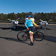 ENGLISH TOWN, NEW JERSEY: Members of the Major Taylor Cycling Club of New Jersey sit for team fotos infant of a Twin Turbo propeller Cesna airplane at the Old Bridge Airport in English Town, NJ on Saturday, March 20, 2021, (©Brian B Price/TheFotodesk)