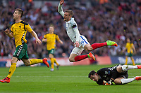 Football - 2016 / 2017 World Cup Qualifier - UEFA Group F: England vs. Lithuania<br /> <br /> Jamie Vardy of England goes flying over the top of Ernestas Setkus of Lithuania after he rushes off his line at Wembley.<br /> <br /> COLORSPORT/DANIEL BEARHAM