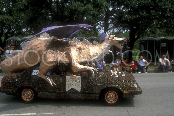 Stock photo of a metallic dragon on top of a car