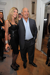 LISA TCHENGUIZ and SIR PHILIP GREEN at a party to launch the Georgina Chapman collection for Garrard held at Garrard, Albermarle Street, London on 4th November 2009.