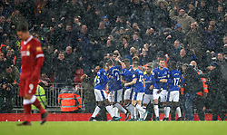 Everton's Wayne Rooney celebrates scoring his side's first goal of the game with team mates during the Premier League match at Anfield, Liverpool.