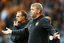 Hull City manager Grant McCann (right) gestures on the touchline during the Sky Bet Championship match at the John Smith's Stadium, Huddersfield. Picture date: Saturday October 16, 2021.