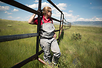 Anna Senecal, an aquatic biologist with the Wyoming Game and Fish Department, stands by an enclosure erected with the help of volunteers last week around a section of Flat Creek on the National Elk Refuge. Senecal hopes the enclosures will help protect willows planted on the bank of the creek from foraging elk.