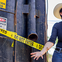 081915       Cable Hoover<br /> <br /> Navajo Nation Attorney General Ethel Branch pulls a greasy arm back from the intake line of a large tank in Shiprock Wednesday. The tank was full of water that was intended to compensate for a shortage following the EPA spill in Animas river.