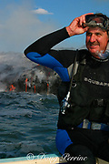 diver and underwater lava sculptor Bud Turpin dons gear and prepares to enter the water as hot lava from Kilauea Volcano pours into the ocean behind him, Hawaii Island (the Big Island ), Hawaii, U.S.A. ( central Pacific Ocean )
