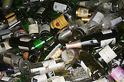 empty glass bottles in recycle container