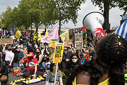 London, UK. 29th May, 2021. Marvina Newton, founder of United for Black Lives, speaks passionately of her friend Sasha Johnson to activists from civil liberties groups sitting in the road on the Victoria Embankment during a Kill The Bill National Day of Action in protest against the Police, Crime, Sentencing and Courts (PCSC) Bill 2021.