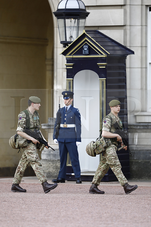 © Licensed to London News Pictures. 24/05/2017. London, UK. Soldiers are seen on duty at Buckingham Palace.. The terrorism threat level has been raised to critical and Operation Temperer has been deployed. 5,000 troops are taking over patrol duties under police command. Photo credit: Peter Macdiarmid/LNP