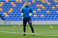 AFC Wimbledon goalkeeper Connal Trueman (1) warming up prior to kick off during the EFL Sky Bet League 1 match between AFC Wimbledon and Lincoln City at Plough Lane, London, United Kingdom on 2 January 2021.