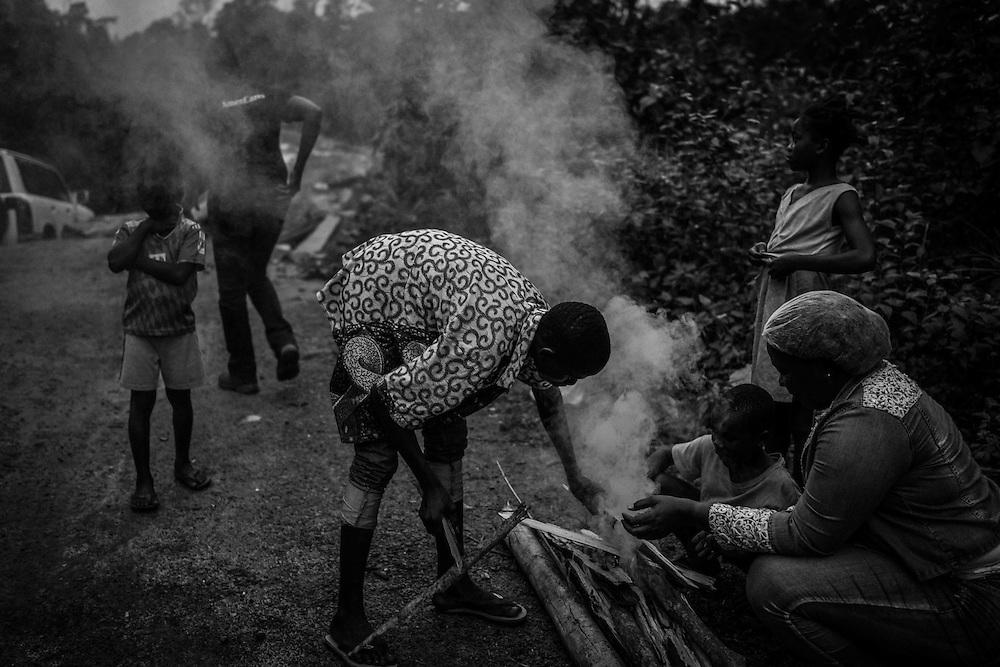 Making fire, waiting for rescue. John Logan Town, Liberia.