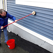 Lifelong St. John's resident Dave Doherty works on the facade of his blue Signal Hill Road home in St. John's, Newfoundland and Labrador, Canada, on Monday, June 3, 2019. THE BLADE/KURT STEISS <br /> SPT Walleye03p