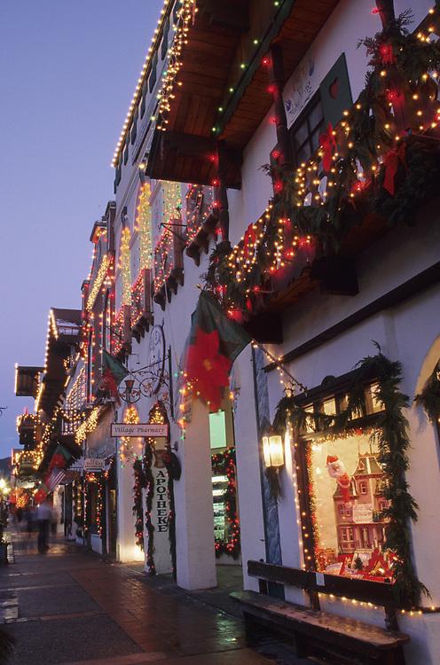 North America, USA, Washington, Leavenworth. Christmas lights glow on Front Street during annual Christmas festival