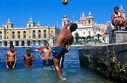MALTA VALETTA JUL00 - Local boys play ball in the water in the port of Marsa, Valetta...jre/Photo by Jiri Rezac..© Jiri Rezac 2000..Tel:   +44 (0) 7050 110 417.Email: info@jirirezac.com.Web:   www.jirirezac.com