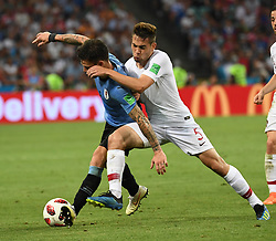 SOCHI, June 30, 2018  Raphael Guerreiro (R) of Portugal vies with Nahitan Nandez of Uruguay during the 2018 FIFA World Cup round of 16 match between Uruguay and Portugal in Sochi, Russia, on June 30, 2018. Uruguay won 2-1 and advanced to the quarter-final. (Credit Image: © Chen Cheng/Xinhua via ZUMA Wire)