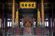 Imperial Emporer's throne in the Hall of Supreme Harmony. The Forbidden City was the Chinese imperial palace from the Ming Dynasty to the end of the Qing Dynasty. It is located in the middle of Beijing, China, and now houses the Palace Museum. For almost 500 years, it served as the home of emperors and their households, as well as the ceremonial and political center of Chinese government. Built in 1406 to 1420, the complex consists of 980 buildings. The palace complex exemplifies traditional Chinese palatial architecture, and has influenced cultural and architectural developments in East Asia and elsewhere. The Forbidden City was declared a World Heritage Site in 1987, and is listed by UNESCO as the largest collection of preserved ancient wooden structures in the world.