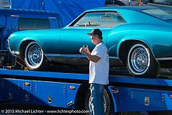 "John D'Agostino with his 1968 Buick Riviera ""PANTHEON"" at the docks before the Mooneyes Yokohama Hot Rod & Custom Show. Yokohama, Japan. December 5, 2015.  Photography ©2015 Michael Lichter."