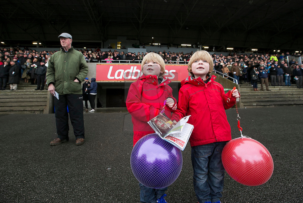 Repro Free: 02/05/2015 Twins Jack and Cooper Byrne (6) from Naas watch the action at the AES Family Day during the last day of the Punchestown Racing Festival. Picture Andres Poveda