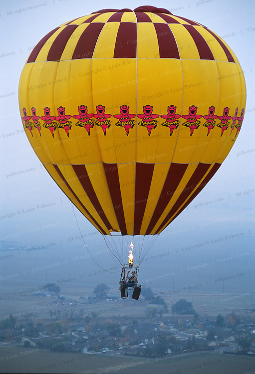 """Experimental balloonist Bob Nungester of Cupertino rises in his lawn chair near Coalinga, California.  Called """"Cloud-hoppers"""" these single person aircraft can rise and fall more quickly than a traditional hot-air balloons."""