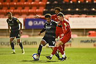 Tarryn Allarakhia of Crawley Town and Leyton Orient's Sam Ling(2) battles for possession during the EFL Sky Bet League 2 match between Leyton Orient and Crawley Town at the Breyer Group Stadium, London, England on 19 December 2020.