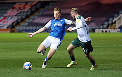 Frankie Kent of Peterborough United in action with George Cooper of Plymouth Argyle - Mandatory by-line: Joe Dent/JMP - 24/11/2020 - FOOTBALL - Weston Homes Stadium - Peterborough, England - Peterborough United v Plymouth Argyle - Sky Bet League One