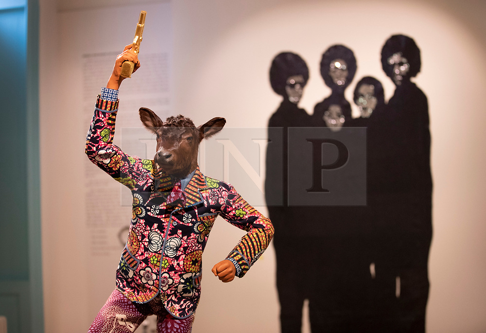 © Licensed to London News Pictures. 11/06/2019. London, UK. Yinka Shonibare's 'Revolution Kid (Calf, 2012)' (L) is displayed with Sanford Biggers'<br /> 'Woke, 2016' at the 'Get Up, Stand Up Now: Generations of Black Creative Pioneers' exhibition at Somerset House, London. This major new exhibition celebrates the past 50 years of Black creativity in Britain and beyond. Beginning with the radical Black filmmaker Horace Ové and his dynamic circle of Windrush generation creative peers and extending to today's brilliant young Black talent globally, a group of around 100 interdisciplinary artists are showcasing their work together for the first time, exploring Black experience and influence, from the post-war era to the present day. The exhibition opens on June 12, 2019 and runs until September 15, 2019.  Photo credit: Peter Macdiarmid/LNP