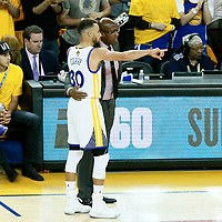 01 June 2017: Golden State Warriors guard Stephen Curry (30) talks to Golden State Warriors head coach Mike Brown during the Golden State Warriors 113-90 victory over the Cleveland Cavaliers, in game 1 of the 2017 NBA Finals, at the Oracle Arena, Oakland, California, USA.
