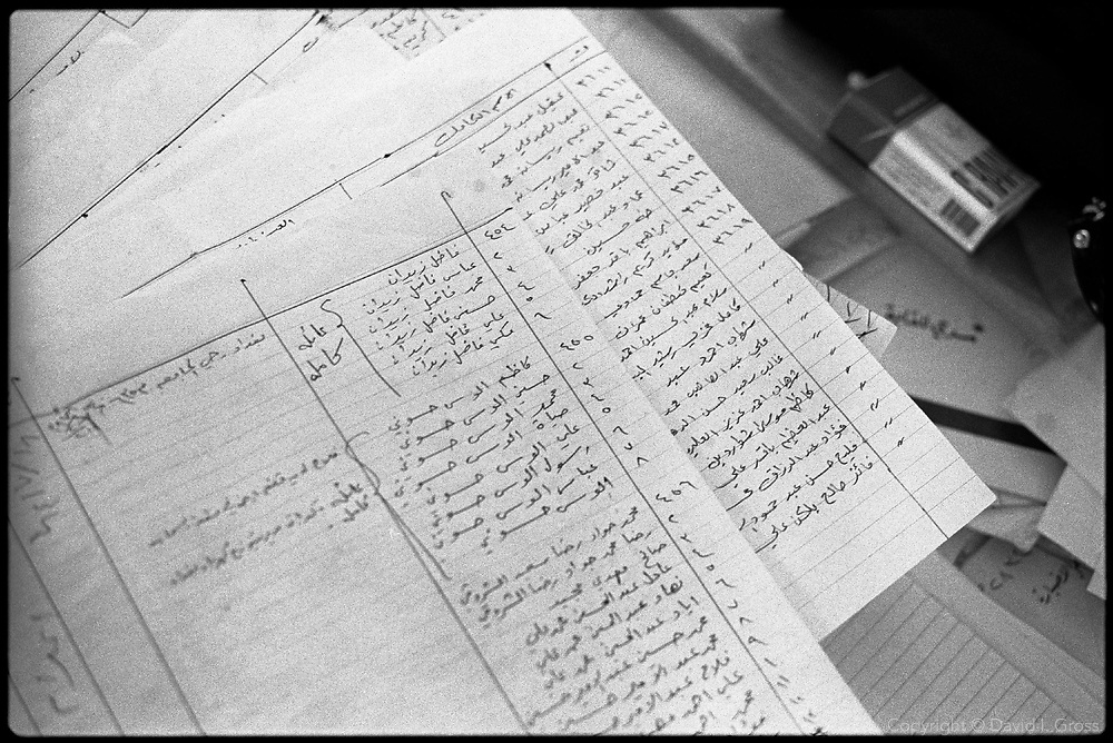 Researchers at the Committe of Freed Prisoners in Baghdad, Iraq, sift through police files taken from looted ministries, looking for execution and imprisonment records. Human Rights Watch estimates over 200,000 people missing, and the Committee has established offices in many cities in Iraq, sifting the remains of Saddam Hussein's government for clues to their where-abouts.