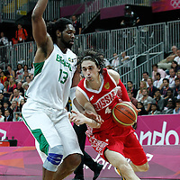 02 August 2012: Russia Alexey Shved drives past Nene Hilario during 75-74 Team Russia victory over Team Brazil, during the men's basketball preliminary, at the Basketball Arena, in London, Great Britain.