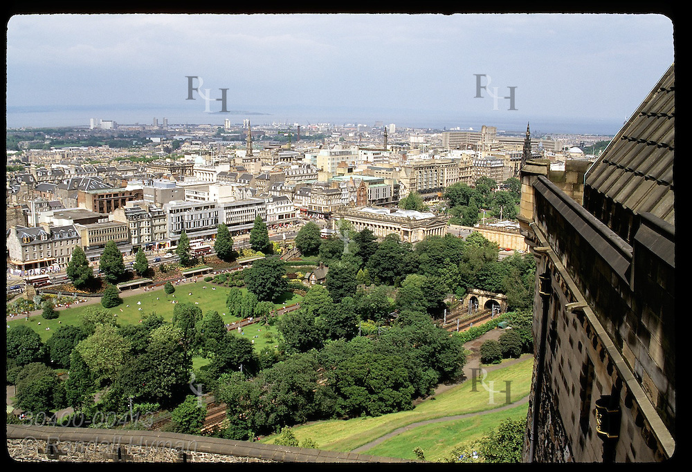 View of downtown district from ramparts of Edinburgh Castle with Firth of Forth afar; Edinburgh. Scotland