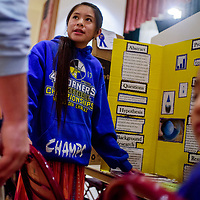Little Singer Community School sixth-grader Anysa Tso show of her project about foam slime during the Navajo Nation Science Fair Wednesday at Red Rock Park in Gallup.