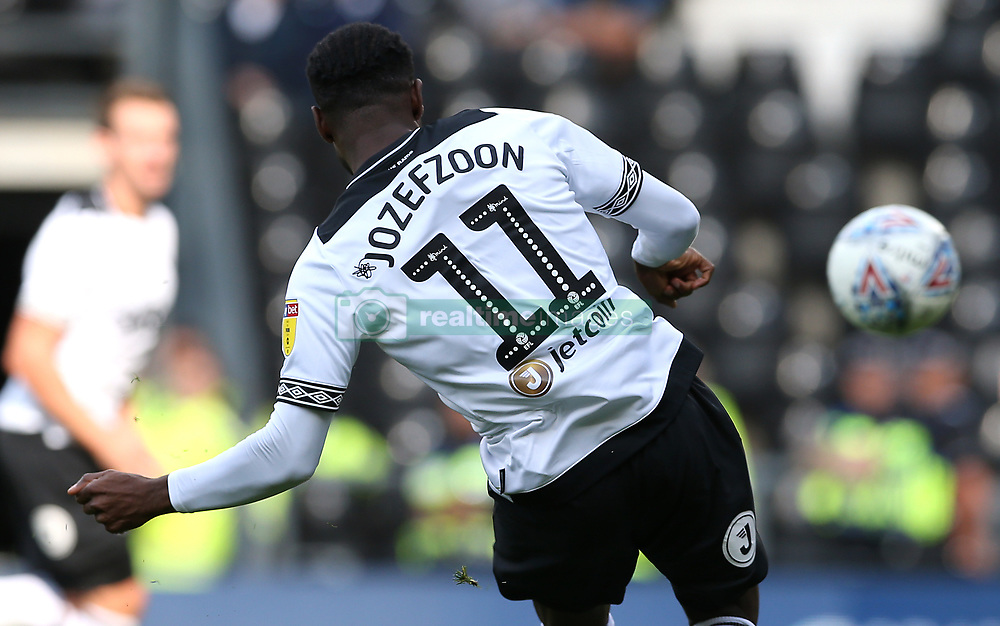 Derby County's Florian Jozefzoon with the Mind Charity branding on his back