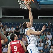Anadolu Efes's Estaban Batista (R) during their Turkish Basketball League Play Off match Anadolu Efes between Pinar Karsiyakaat Sinan Erdem Arena in Istanbul, Turkey, Sunday, May 06, 2012. Photo by TURKPIX