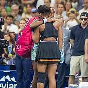 2019 US Open Tennis Tournament- Day Six.  Coco Gauff of the United States and Naomi Osaka of Japan embrace after the on court interviews after Naomi Osaka's victory in the Women's Singles Round three match on Arthur Ashe Stadium during the 2019 US Open Tennis Tournament at the USTA Billie Jean King National Tennis Center on August 31st, 2019 in Flushing, Queens, New York City.  (Photo by Tim Clayton/Corbis via Getty Images)