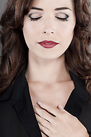 Closeup portrait of sensuous brown haired woman with beautiful red lips and eyes closed