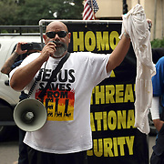 Ruben Israel (left) of the Bible Believers preaches during the Republican National Convention in Tampa, Fla. on Wednesday, August 29, 2012. (AP Photo/Alex Menendez)