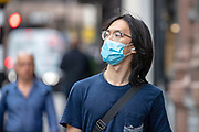 People wearing face protective surgical masks walk along Strand in Central London on Friday, July 24, 2020, as the new rules on wearing masks in England have come into force, with people going to shops, banks and supermarkets now required to wear face coverings. <br /> Authorities said that Police can hand out fines of 100 pounds if people refuse, but authorities are hoping that peer pressure will prompt compliance. (VXP Photo/ Vudi Xhymshiti)
