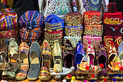 Turkish caps, hats silk slippers in the Misir Carsisi Egyptian Bazaar market in Istanbul, Turkey