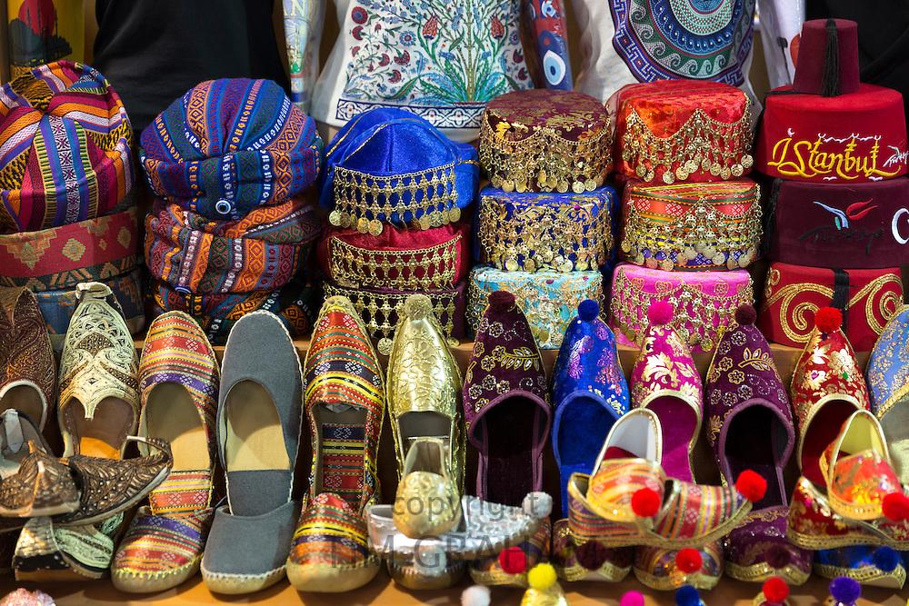 Turkish caps, hats silk slippers in the Misir Carsisi Egyptian Bazaar market in Istanbul, Turkey