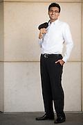 Farhan Latif poses for a portrait outside Milpitas City Hall in Milpitas, California, on April 11, 2014. (Stan Olszewski/SOSKIphoto)