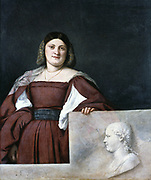 Portrait of a Lady 'La Schiavona'  (Woman of Dalmatia) c1510-1512. Oil on canvas.  Woman with hand on parapet on which is sculpted profile bust. Tiziano Vecellio called Titian (c1488/1490-1576) leading painter of  the Venetian school.