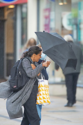 © Licensed to London News Pictures. 02/11/2020.  <br /> Bromley, UK. A shopper fighting the wind and the rain to get her shopping done. After the second lockdown announcement by Prime Minister Boris Johnson at the weekend the number of Christmas shopping days has been halved. Shoppers flock to Bromley High Street in South East London today to by gifts. Photo credit:Grant Falvey/LNP