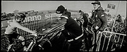 """""""A pack with 40 rolls of 35mm films in my fridge has for a long time been looking at me, so I did decided to use my old Widelux panorama camera for this reportage and use them up.<br /> The Japanese camera, first produced in 1958, utilises a slit rather than a shutter, while the lens pivots – producing a distorted effect that was something of a leap into the unknown for the photographer. """"Not having a clue what to expect was both fascinating and at the same time frightening.<br />  """"Many of the images from behind the scenes are shot on 1/15 due to low light. It takes the camera approximately four seconds to take one frame, so you can't control anything and most movement in the image will be blurred. That works sometimes, and sometimes not.<br /> """"It was so funny to work with the camera and only think in panoramas. It was the only camera I took to the race, so I could not chicken out and switch to the normal digital camera."""""""