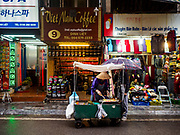 27 DECEMBER 2017 - HANOI, VIETNAM: A street food vender in the Old Quarter of Hanoi.      PHOTO BY JACK KURTZ
