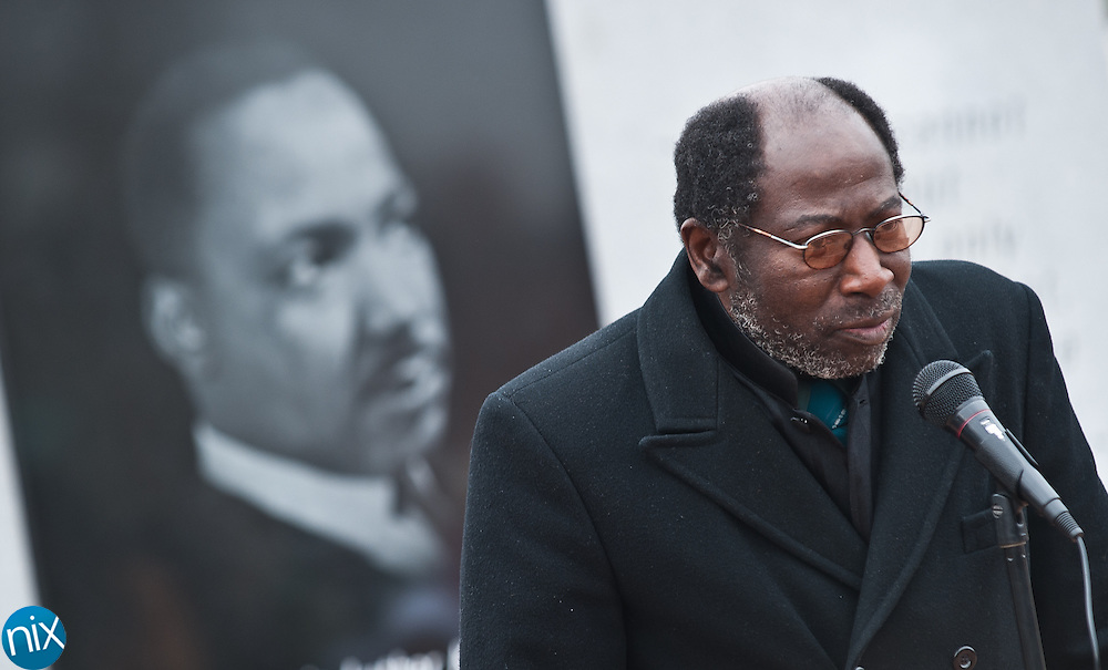 Pastor Roland Jordan prays during a wreath laying ceremony in honor of  Dr. Martin Luther King Jr. put on by the Logan Community Association Monday afternoon at the MLK monument in Concord. (Photo by James Nix)