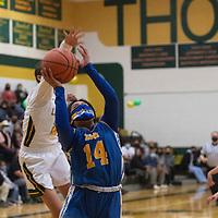 Zuni Thunderbird Lani Penketewa (14) drives to the basket in the third quarter against the Thoreau Lady Hawks Monday night in Thoreau.