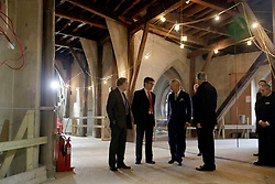 The Prince of Wales (third left) talks with project architect Ptolemy Dean (second left) Clerk of Works Jim Vincent (left) and the Dean of Westminster John Hall during his visit to The Queen's Diamond Jubilee Galleries, at Westminster Abbey in London.