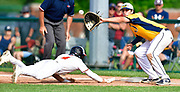 Edwardsville baserunner Hayden Moore dives safely back to first base to avoid a pickoff throw to OFallon first baseman Corey Quintal. OFallon defeated Edwardsville in a baseball sectional playoff game at Edwardsville High School in Edwardsville, IL on Wednesday June 9, 2021. <br /> Tim Vizer/Special to STLhighschoolsports.com.