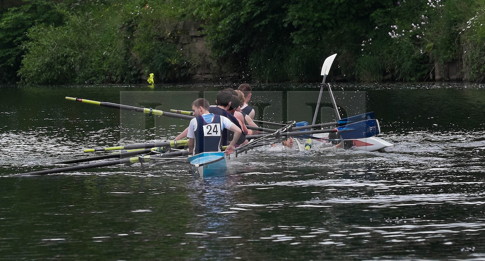 © Licensed to London News Pictures.13/06/15<br /> Durham, England<br /> <br /> A single sculler collides with an eight man crew boat and capsizes in the river during the 182nd Durham Regatta rowing event held on the River Wear. The origins of the regatta date back  to commemorations marking victory at the Battle of Waterloo in 1815. This is the second oldest event of this type in the country and attracts over 2000 competitors from across the country.<br /> <br /> Photo credit : Ian Forsyth/LNP